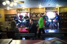 Hillary gets ready to sit down with fake ordinary people in Iowa.