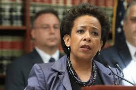 Attorney General Loretta Lynch, a female version of Eric Holder.